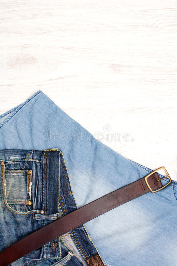 Jean clothes on wood. Fashion jean clothes on woodn stock photos