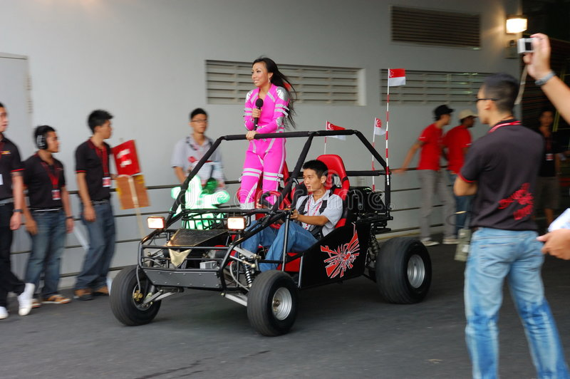 Jean Danker entering stage on buggy stock photography