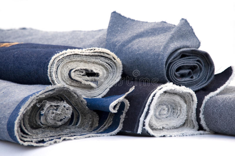 Jeans. Blue jeans rolls on a white background stock photo