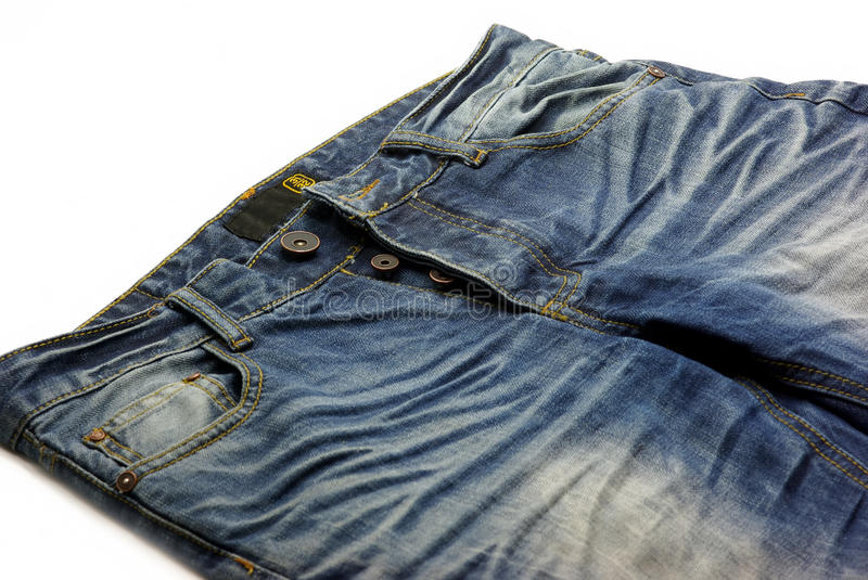 Jeans. Modern blue jeans on white royalty free stock images