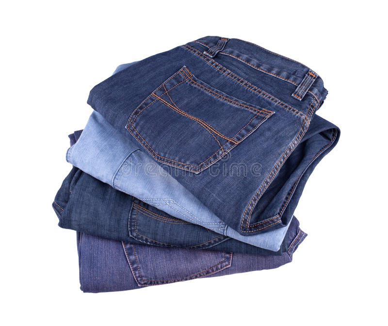 Jeans. Stack of jeans isolated on white background stock image
