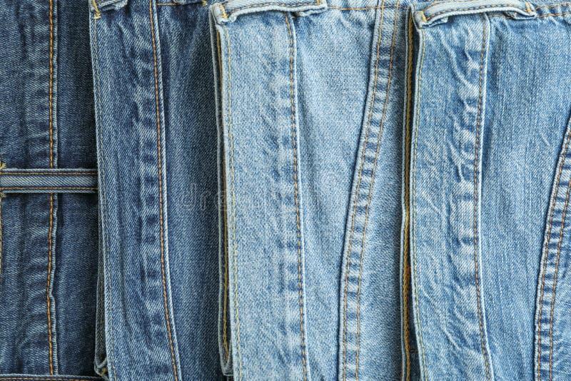 Jeans av olika färger som bakgrund royaltyfria bilder