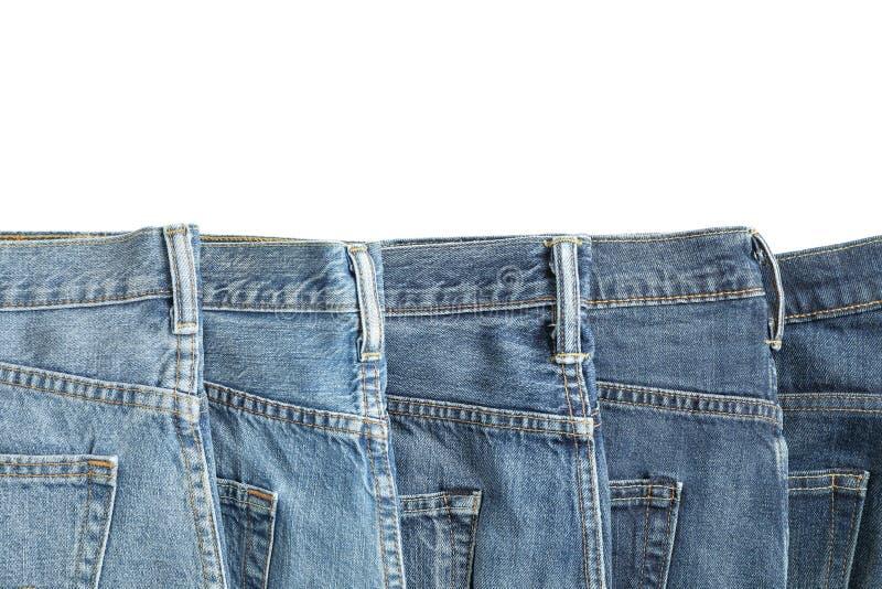 Jeans av olika färger som isoleras på vit bakgrund royaltyfria foton