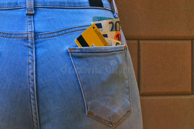 Jeans back pocket with cash and plastic card stock photos