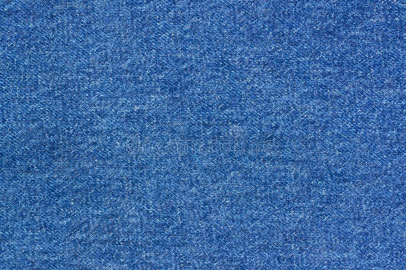 Jeans background denim pattern. Classic dark blue stonewashed fabric texture. Background of jeans canvas close up stock image