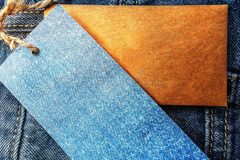 Jeans with blank paper price tag. Logging for shop and sale royalty free stock photos
