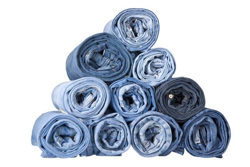 Jeans bleus de denim de roulis images libres de droits