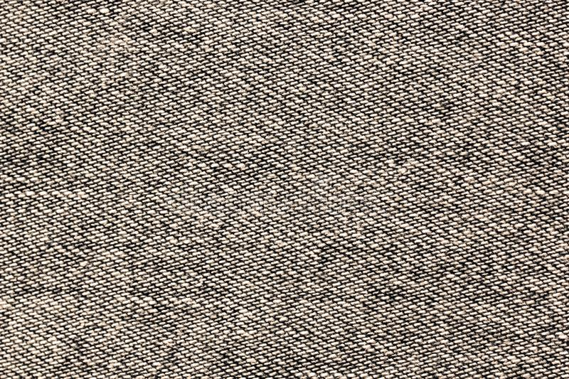 Jeans cloth, backdrop in monochrome color, sepia. Background of denim fabric. Jeans cloth, backdrop in monochrome color, sepia. Horizontal orientation stock images