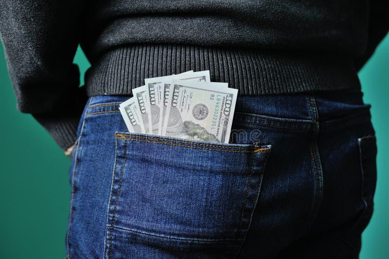 Jeans con i dollari nella casella fotografia stock