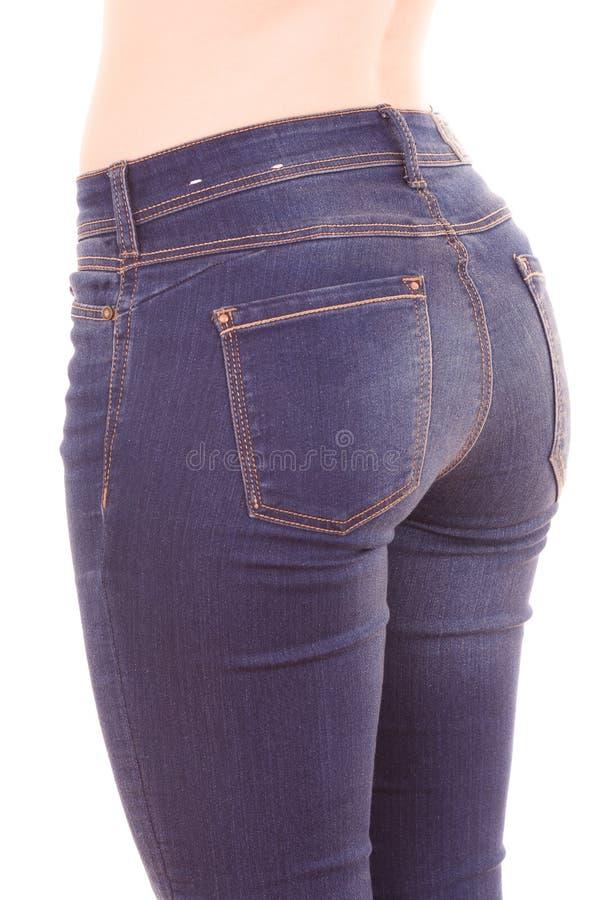 Jeans d'uso della bella giovane donna topless esile fotografia stock libera da diritti