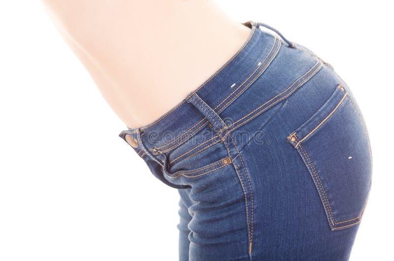 Jeans d'uso della bella giovane donna topless esile immagini stock