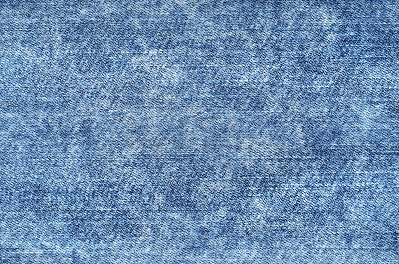 Jeans dans le bleu acide de lavage Fond de denim, texture, fin  Fa image libre de droits