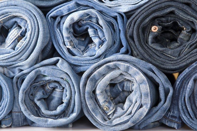 Jeans de denim de roulis photo stock