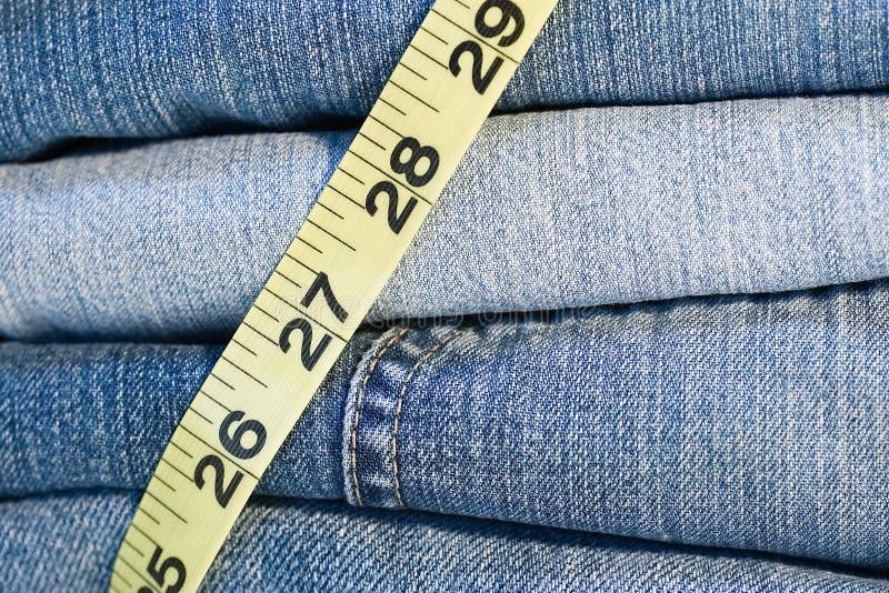 Jeans de denim mesurant la bande image libre de droits