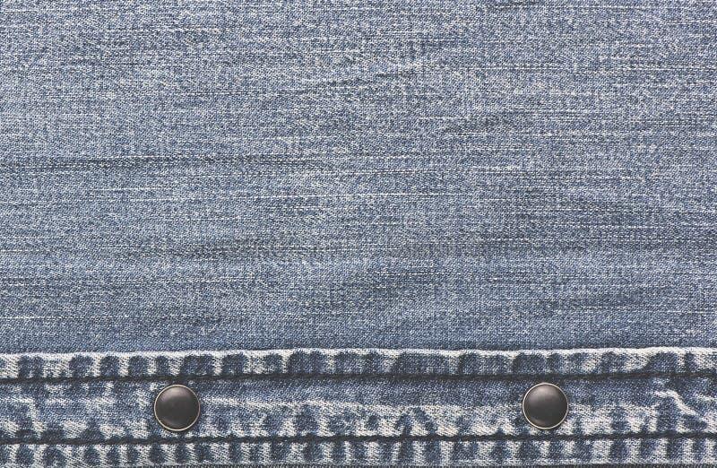Jeans del denim con lacerato Struttura lacerata del denim dei jeans fotografia stock
