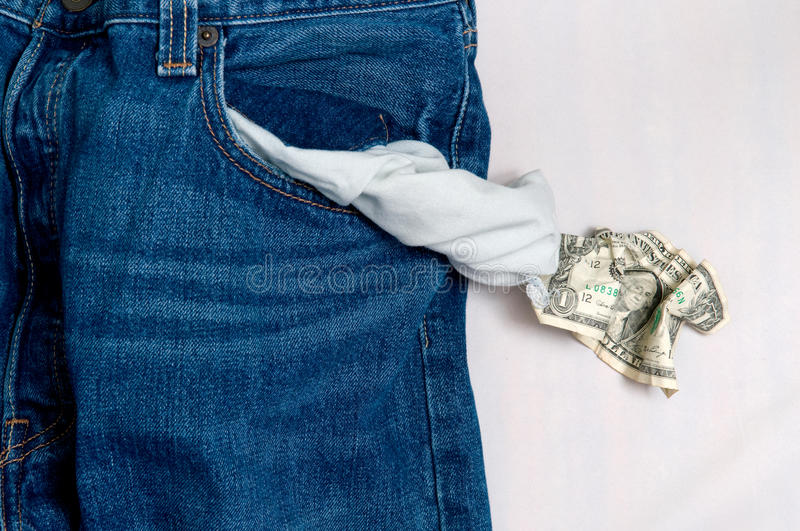 Jeans with empty pocket and the last one dollar. The photo of a jeans with empty pocket and the last one dollar stock image