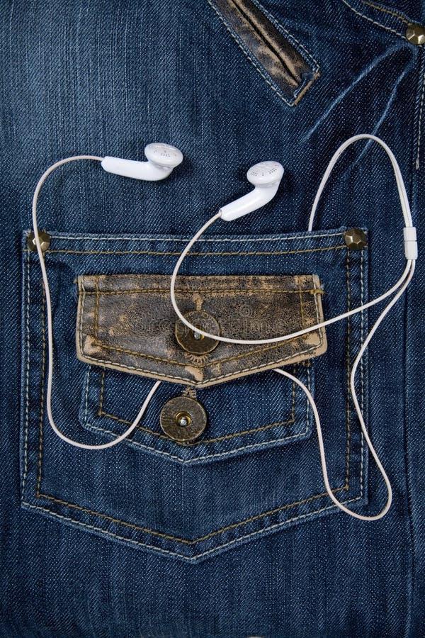 Jeans et écouteurs photos libres de droits