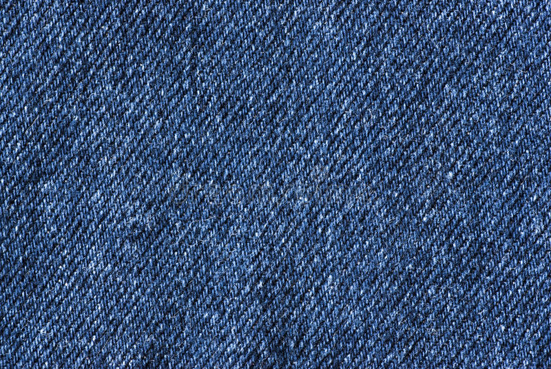 Jeans Fabric. A fragment of colored jeans fabric royalty free stock images