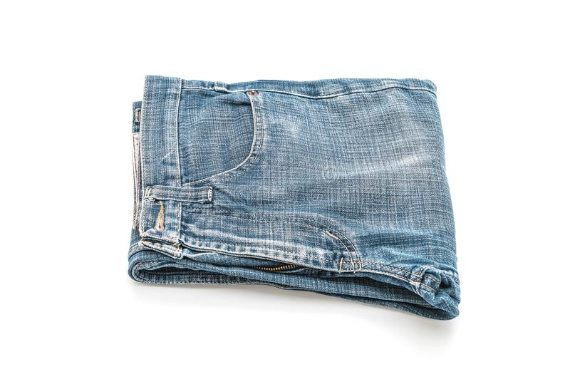 Jeans folded on white background. Jeans folded isolated on white background stock image