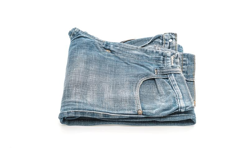 Jeans folded on white background. Jeans folded isolated on white background royalty free stock images
