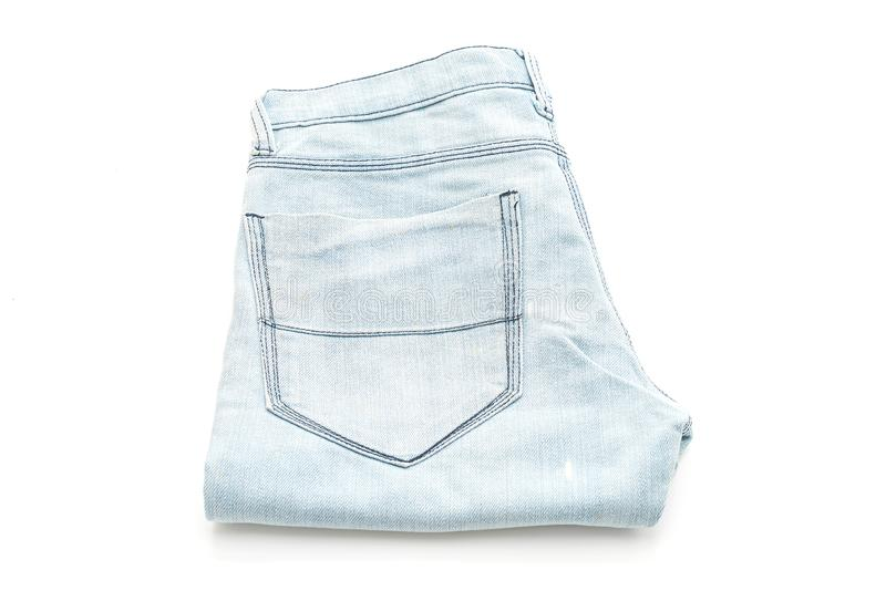 Jeans folded on white background. Jeans folded isolated on white background royalty free stock photos