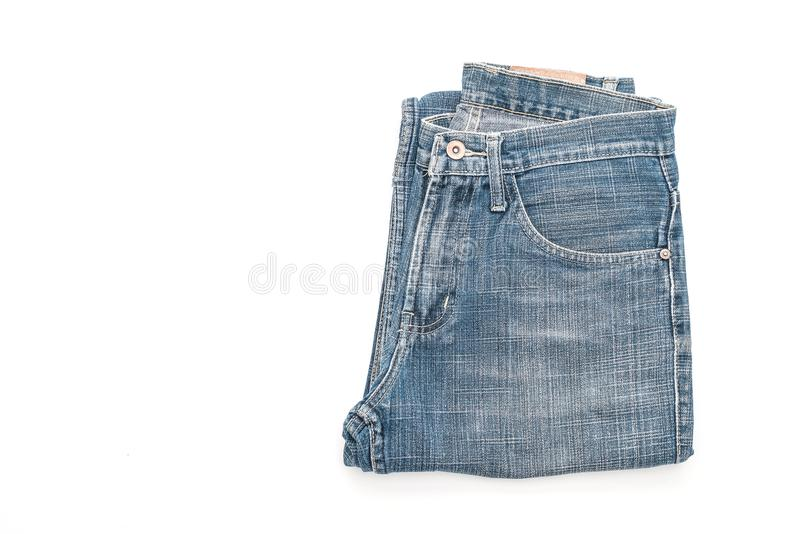 Jeans folded on white background. Jeans folded isolated on white background stock images