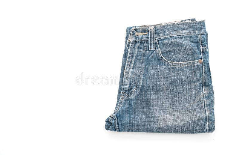 Jeans folded on white background. Jeans folded isolated on white background royalty free stock image