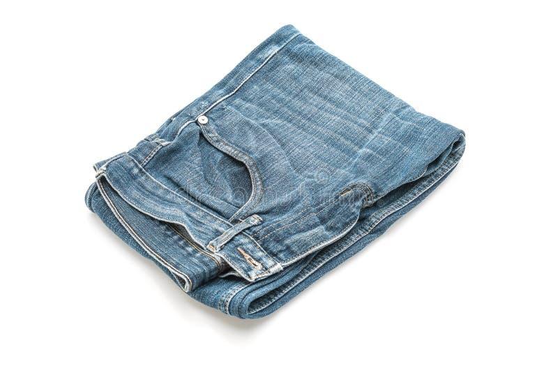 Jeans folded on white background stock image