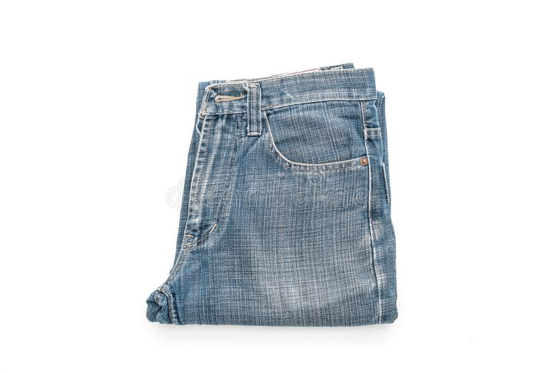 Jeans folded on white background stock photos