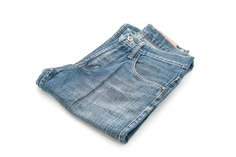 Jeans folded on white background royalty free stock photo