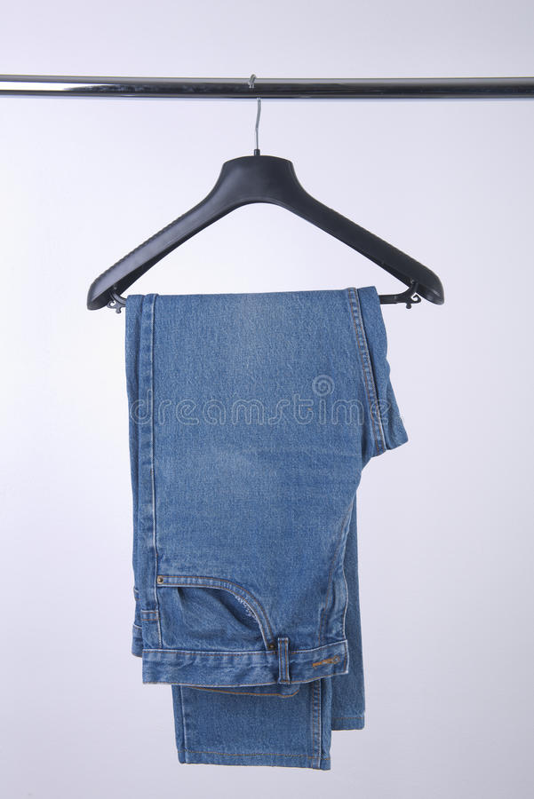 Jeans hung. In an coat hanger stock image
