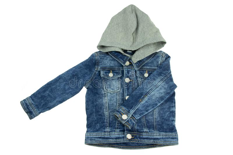 Jeans jacket with detachable hood and folded left arm. Fashionable jacket for child boy. Top view front. stock image