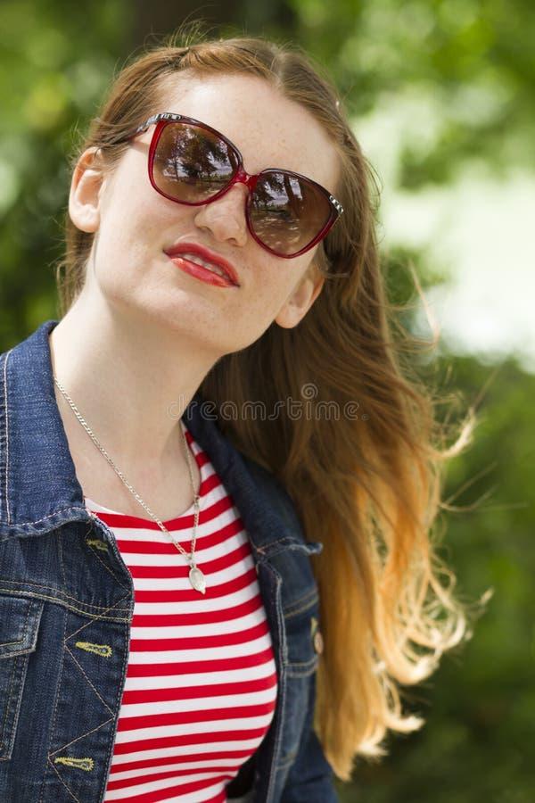 Jeans_Jacket_red_sunglasses-7 lizenzfreies stockfoto