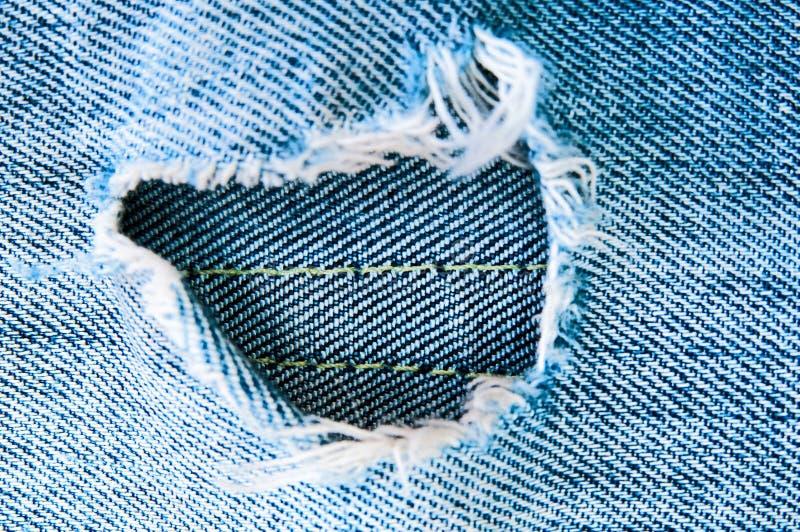 Jeans lacerati blu fotografia stock