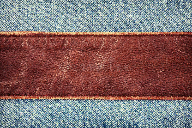Jeans and leather. Textures background royalty free stock image