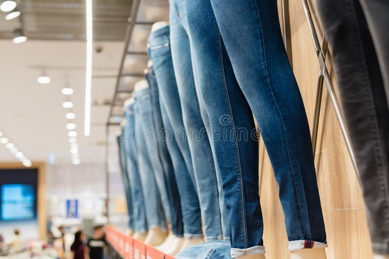 Jeans on a mannequin in the store. Denim sale. royalty free stock photography