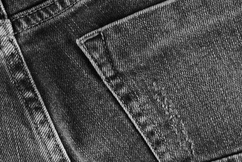 Jeans masern mit Tasche In hohem Grade ausführliche Nahaufnahme des grauen Denims lizenzfreies stockbild