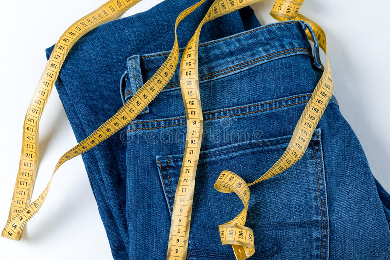 Jeans and measuring tape royalty free stock photo