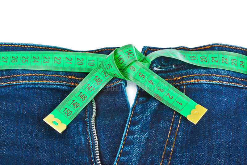 Jeans and measuring tape - slimming concept stock image