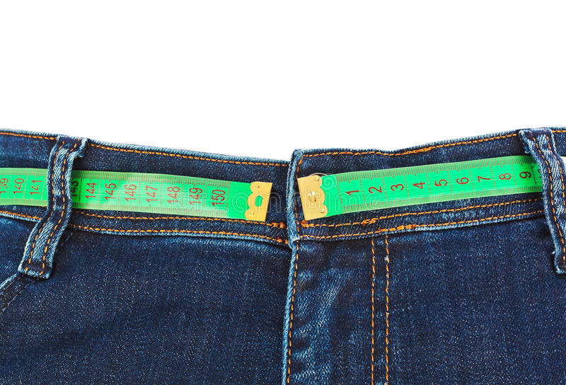 Jeans and measuring tape - slimming concept royalty free stock images