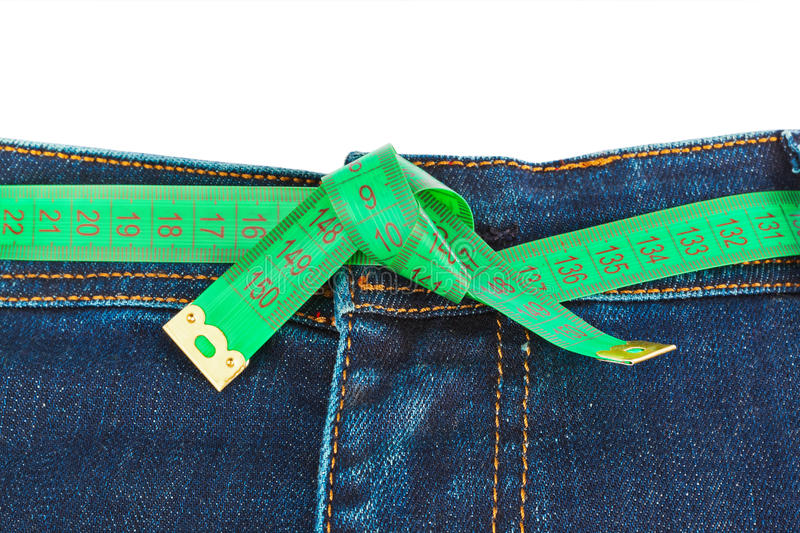 Jeans and measuring tape - slimming concept royalty free stock photos