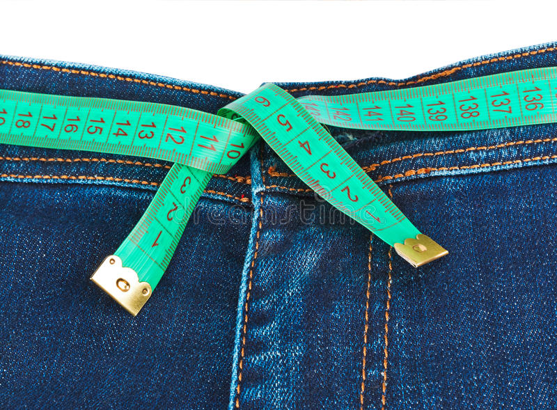Jeans and measuring tape - slimming concept stock photography
