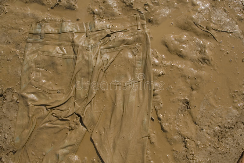Jeans on mud royalty free stock photography