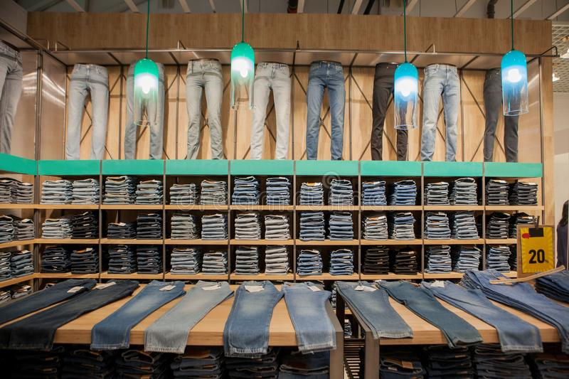 Jeans pants on the store shelf. Blue jeans denim Collection jeans stacked.  stock photography