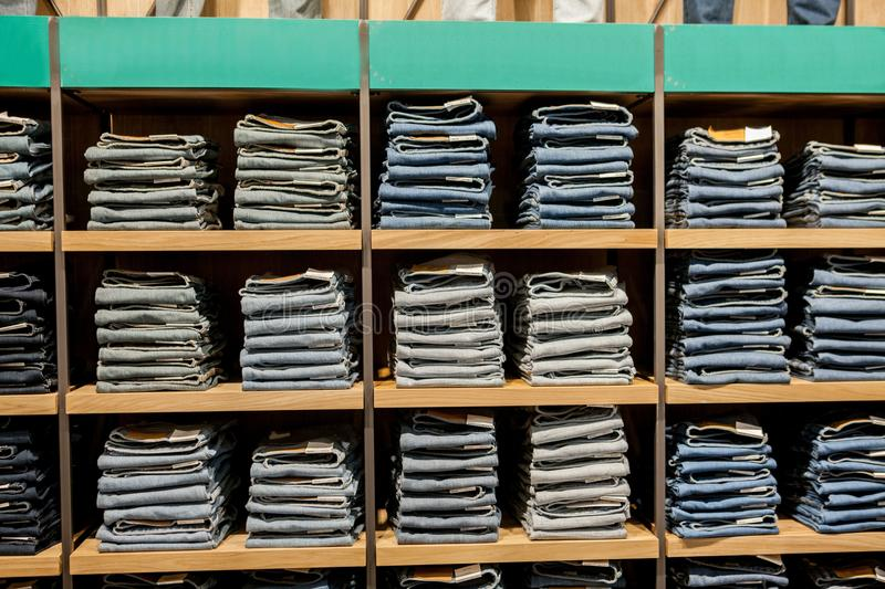 Jeans pants on the store shelf. Blue jeans denim Collection jeans stacked.  stock images