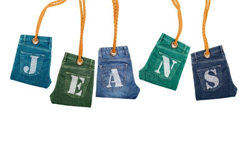 Jeans pliés en tant que labels Photo conceptuelle photos libres de droits