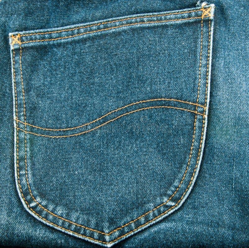 Jeans pocket. Back pocket on blue jeans stock photos