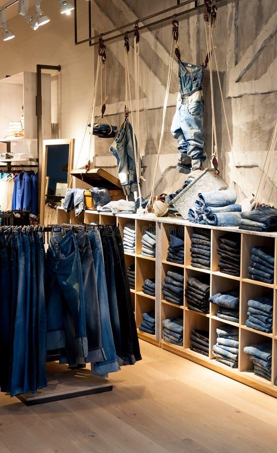 Jeans shop. Interior of modern jeans shop stock photos