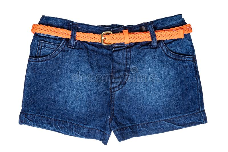 Jeans shorts isolated. Trendy stylish short jeans pants with orange leather belt for child girl isolated on a white background. royalty free stock photos