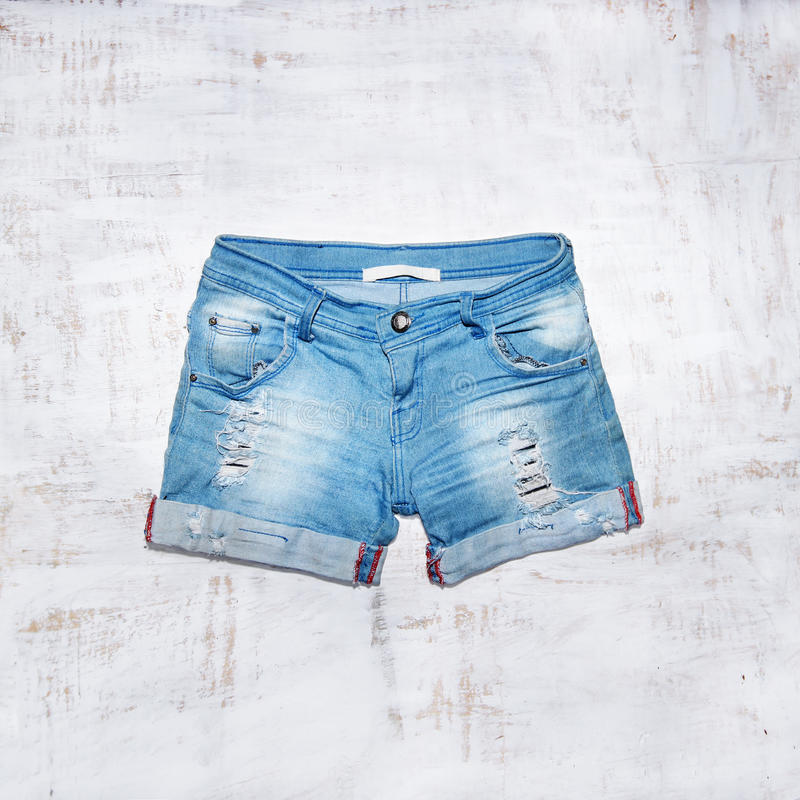 Jeans shorts in wood background royalty free stock photo